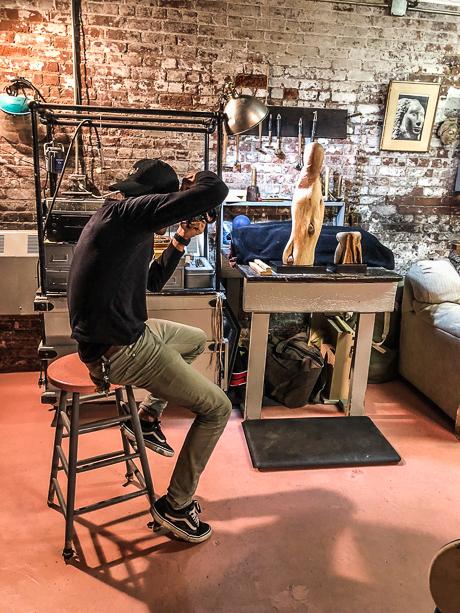 Photographer shooting sculptures